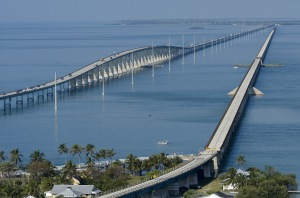 The historic old Seven Mile Bridge in the Florida Keys near Marathon, Fla., is shown at right, cutting through Pigeon Key, a small island that once housed workers who aided the effort to build Henry Flagler's Overseas Railroad. The more modern span, completed in 1982, is at left. (Photo by Andy Newman/Florida Keys News Bureau)